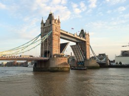 Tower Bridge open for the passing of a sail boat