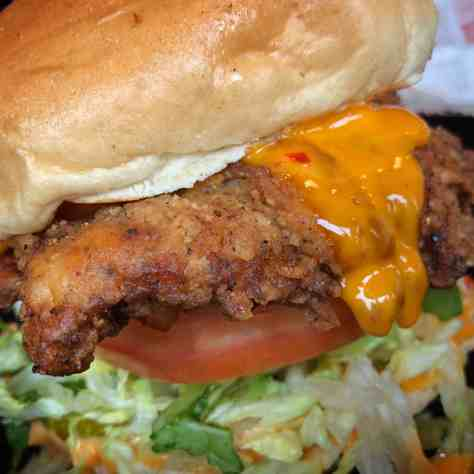 fried chicken sandwich with a sauce that has a kick to it