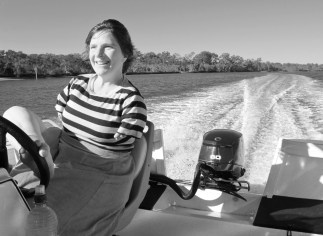 Having fun driving a boat.