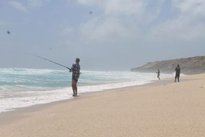 My Dad, brother and sister – beach fishing..