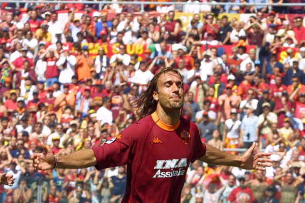 17 Jun 2001: Gabriel Batistuta of Roma celebrates Montella's goal during the Serie A 34th Round League match played between Roma and Parma, played at the Olympic Stadium, Rome Italy. + DIGITAL CAMERA + Mandatory Credit: Grazia Neri/ALLSPORT