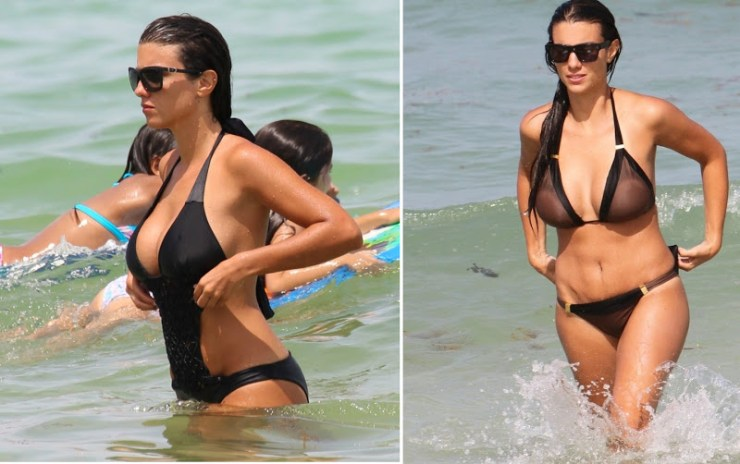 French model Ludivine Sagna seen in a black monokini at the beach in Miami Beach, FL. Ludivine, wife of Manchester City player Bacary Sagna, took a swim in the ocean wearing a one piece swimsuit.Pictured: Ludivine SagnaRef: SPL805595 200714 Picture by: Splash NewsSplash News and PicturesLos Angeles: 310-821-2666New York: 212-619-2666London: 870-934-2666photodesk@splashnews.com
