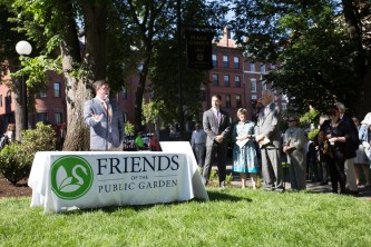 Boston Parks Commissioner Chris Cook speaks, with City Councilor Josh Zakim, Friends Board Chair Leslie Adam, and Friends President Emeritus Henry Lee
