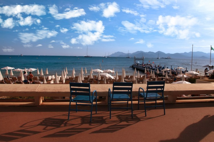CANNES, FRANCE - JULY 5, 2014. Three chairs for guests on Croisette promenade in Cannes, France. CANNES, FRANCE - JULY 5, 2014