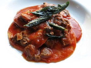 goat brain ravioli with morel tomato sauce