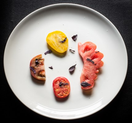 Heirloom tomato salad with ramp oil and pickled chanterelles
