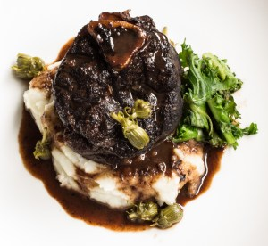 Venison osso buco with dandelion capers