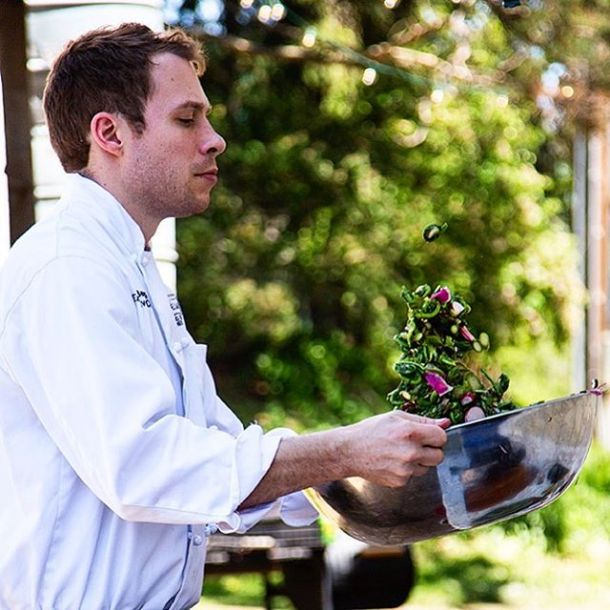 Chef Alan Bergo tossing salad at Piney Hill