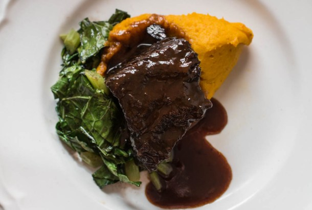 Bison braised in wild grape juice with kabocha squash puree and collards