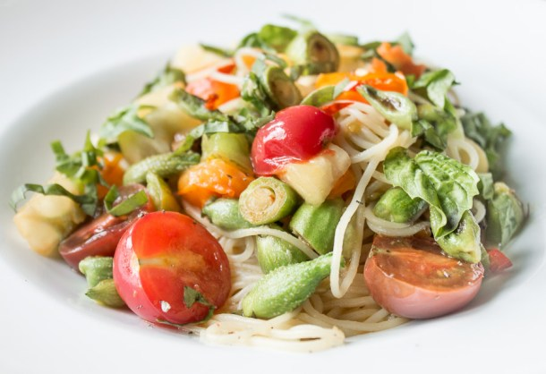 Angel hair pasta with milkweed pods, heirloom tomates and basil