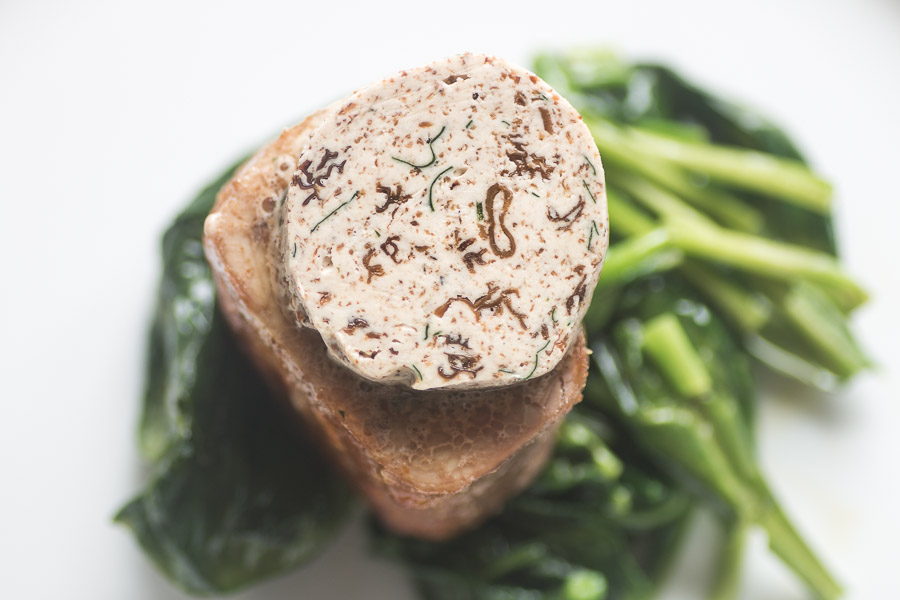 Pork tenderloin with morel mushroom butter and spinach