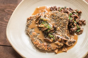 Venison jaegershnitzel with Leccinum mushroom sauce and acorn polenta
