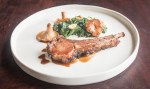 Slow roasted rack of lamb with bolete crust, jus, spinach and chanterelles