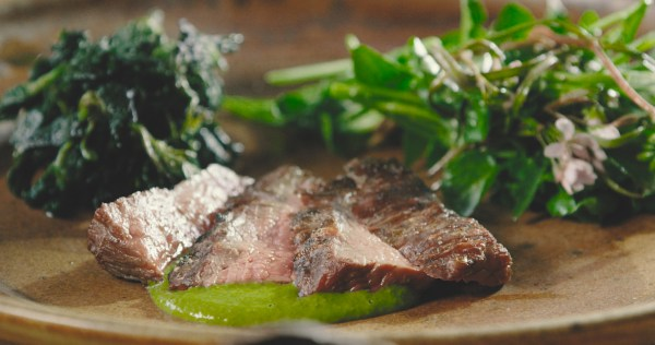 Pastured beef flank steak with ramp leaf salsa verde, glazed nettles, spring beauty, toothwort and watercress salad