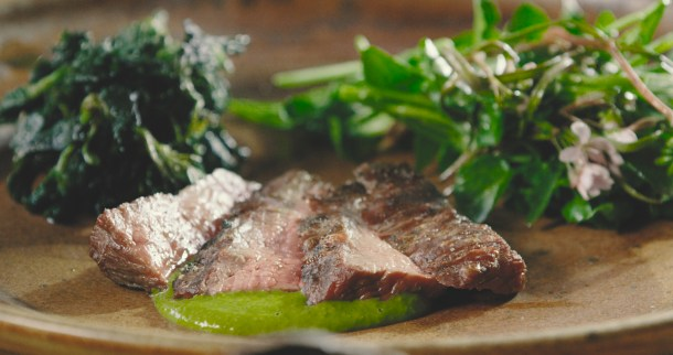 Pastured beef flank steak with ramp leaf salsa verde, glazed nettles, spring beauty, toothwort and watercress salad