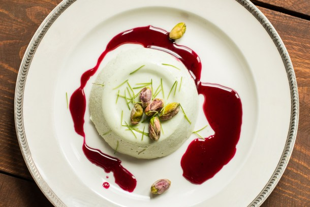 Spruce tip panna cotta recipe with wild grape sauce and pistachios