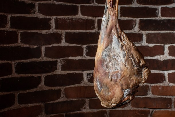 hanging a leg of smoked lamb prosciutto