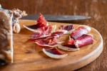 slicing homemade DIY lamb prosciutto
