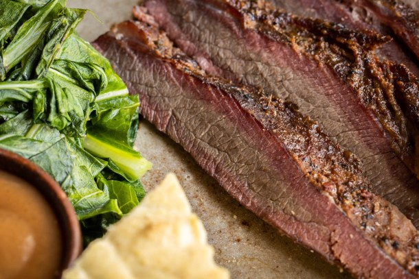 Smoked venison brisket recipe with collard greens and wild plum sauce