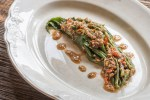 Edible goldenrod shoots with sunflower gomae sauce