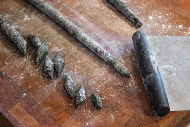 Cutting nettle gnocchi into diamonds with a bench knife