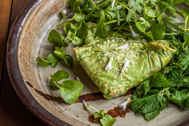 Green nettle crepes with nettle and goat cheese filling served with steamed nettles, toothwort and spring beauty