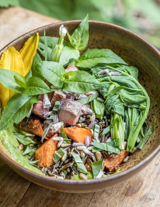 Wild rice bowl with roasted carrots, herbs, sunflower seeds, chickweed, salsa and silphium meristems