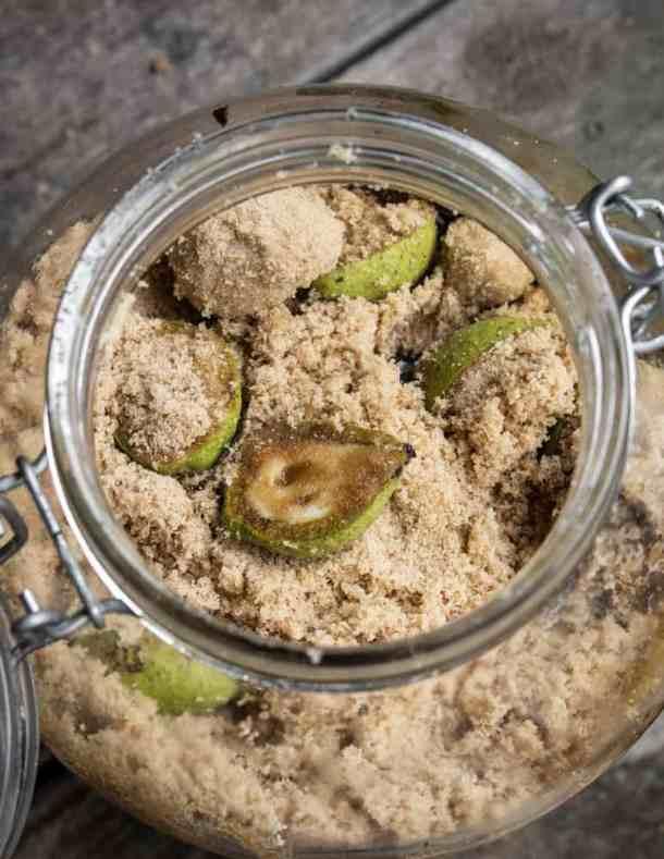 Mixing unripe green black walnuts with sugar
