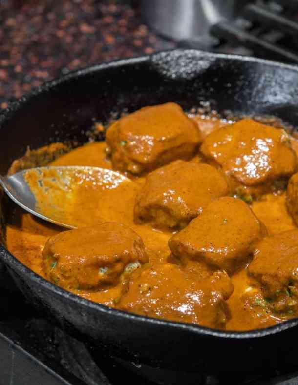 Cooking milkweed bud huazontles in chili sauce