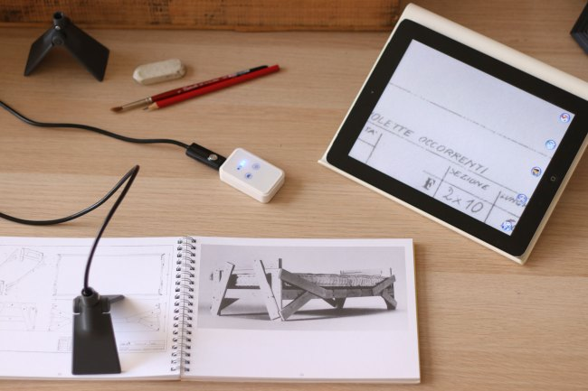 Zoomograph is a zooming device to read and write, all 3D printed.