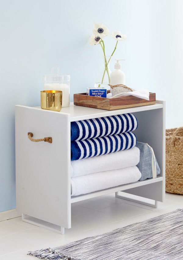 Ikea Rast Dresser into Stylish Bathroom Storage: Paint a basic IKEA RAST chest with the gorgeous white and add rope pulls to create this stylish side stand for your bathroom with extra storage.
