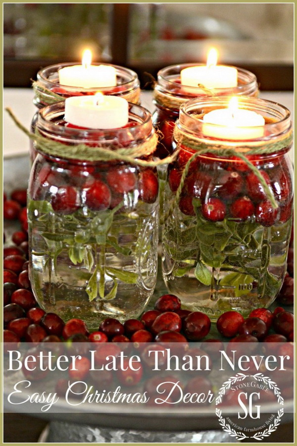 Mason Jar Candles Christmas Decor: Super easy to make these little mason jars with floating candles and fresh cranberries. Perfect decor centerpieces for Christmas table!