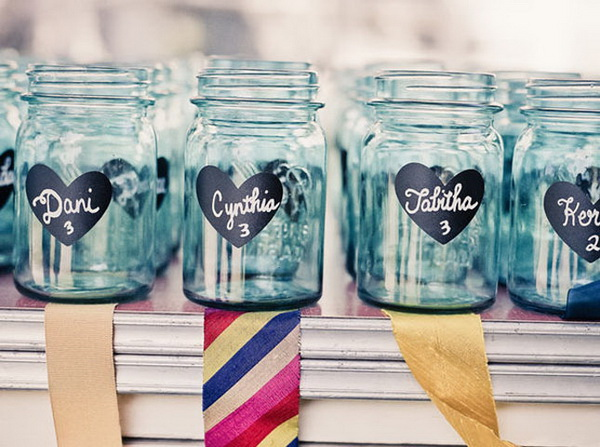 DIY Chalkboard Mason Jars as Escort Cards: Easy to DIY and perfect for spring or summer outdoor weddings.