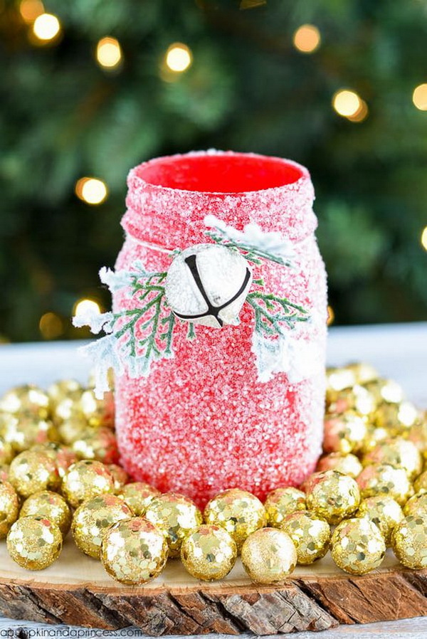 DIY Glitter Mason Jar Luminary: To create a faux snowy finish by chalkpainting mason jars in red and finish with white glitter. It is perfect to be used to adorn our Christmas table  for weddings, parties, and even made into flower vases.