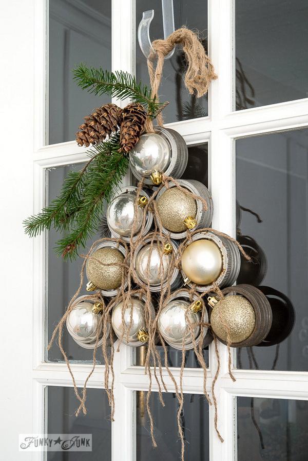 Mason Jar Lid Ornament Christmas Wreath. Nothing says Christmas than a beautiful, festive wreath! Make this mason jar lid wreath this holiday.