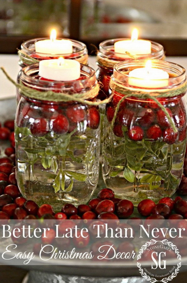 Christmas Mason jar Candles. Place a pretty jar filled with red berries and a candle for a DIY mason jar lantern to light up the night.