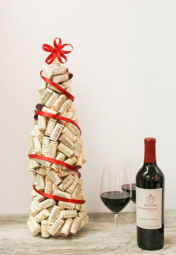 DIY Wine Cork Christmas Tree. Turn the extra corks into a cork Christmas tree complete with a string of lights. It is so easy to make and it will add more rustic warm and charm to your Christmas.