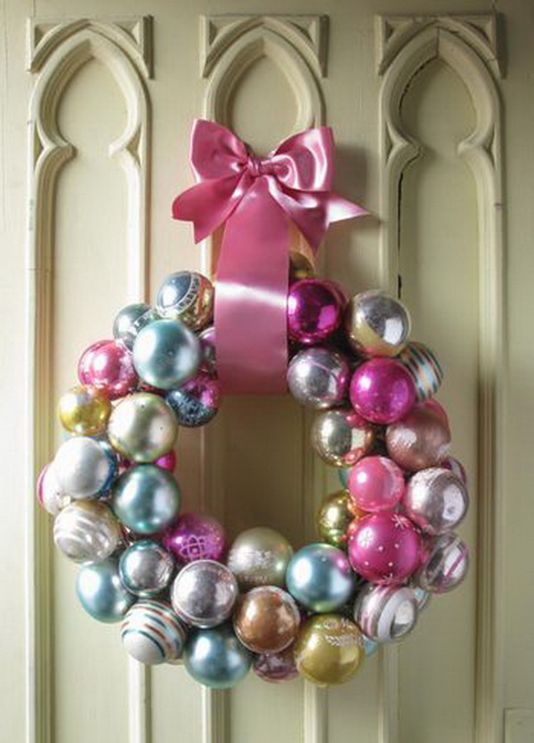 DIY Christmas Ornaments Wreath. Add holiday cheer and warm to your home with this easy to make ornament wreath! Simple but stunning Christmas door decoration idea!