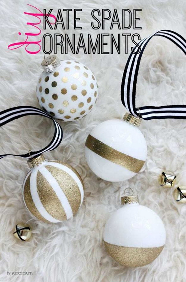 Kate Spade-Inspired DIY Christmas Ornaments: Just with gold glitter spray paint and tape, you can make these stunning and pretty Christmas ornaments.