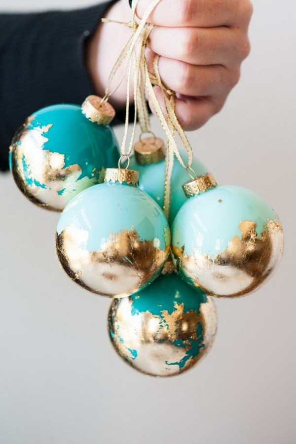 DIY Painted Gold Leaf Ornaments: You won't believe how easy it is to make these painted gold leaf Christmas ornaments! They looks so gorgeous for your Christmas decoration or used as the gifts this holiday season.