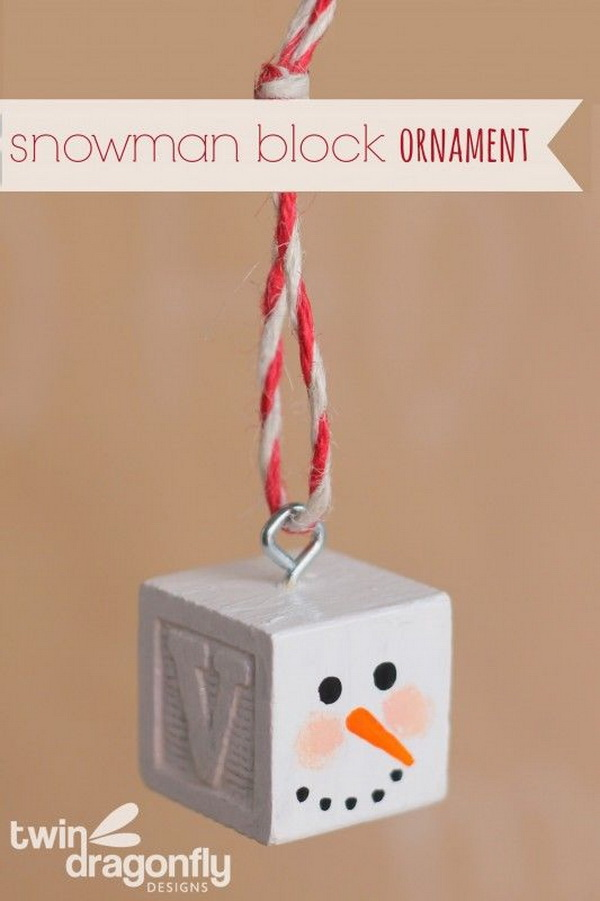Snowman Block Ornament: The cutest Snowman Block Ornament for this Christmas season! All you need is an alphabet block, acrylic paint, a screw eye and some bakers twine. Super easy and fun to make in several steps!
