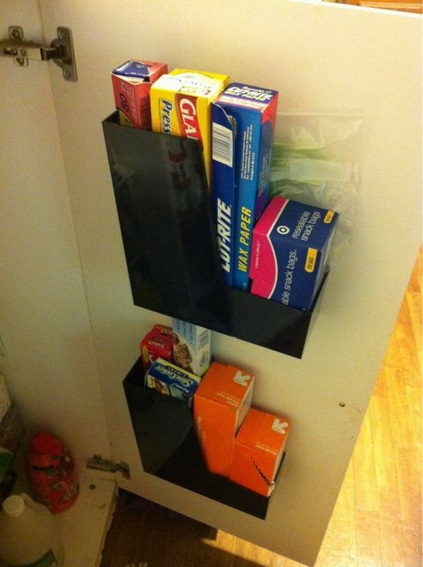 Inside of Cupboards Storage Solution: Screwing a magazine rack to the inside of kitchen cupboards for more space to store bulky items like chopping boards, cleaning products.