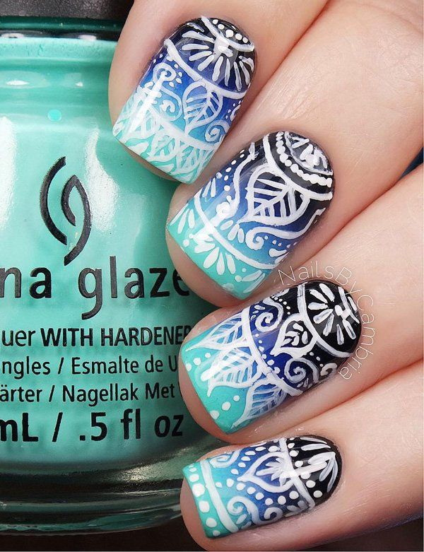 Blue Gradient Background Nails with White Tribal Designs on Top.