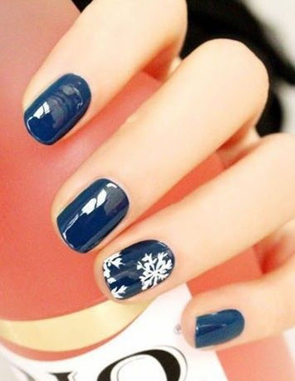 Midnight Blue and White Snowflake Nail Art Design.