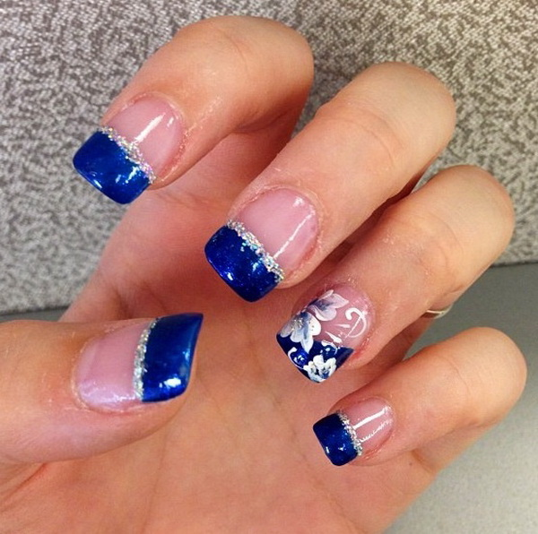 Blue Tipped French Nail Design Accented with a Bit of Flowers.