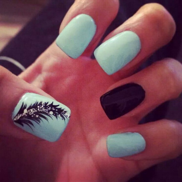 Baby Blue Nails with Black Feather and Glitter.