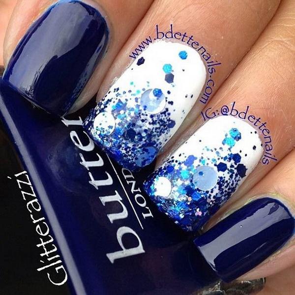 Gradient Glitter White and Dark Blue Nail Design.