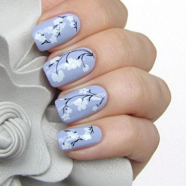 Pruple Base Coating Nails with Flowers on Top.