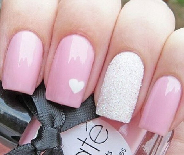 Pastel Pink & Glitter Nails with a White Heart on Top.