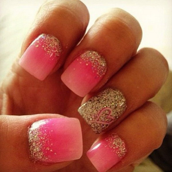 Ombre Pink and Gold Glitter Nail Design with a Heart Accent.